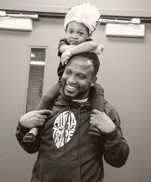 Father holding baby on his shoulders