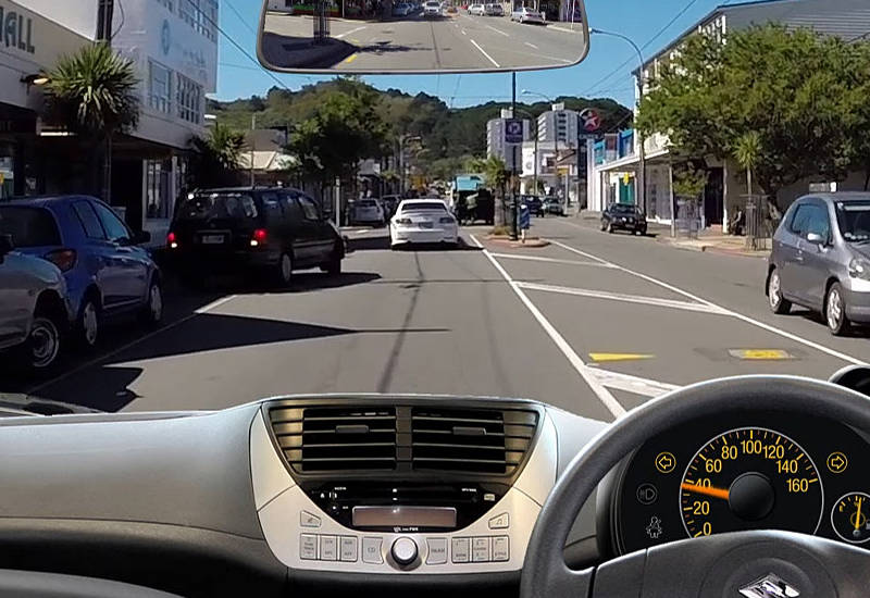 City driving scenario with hazard in front of the car.