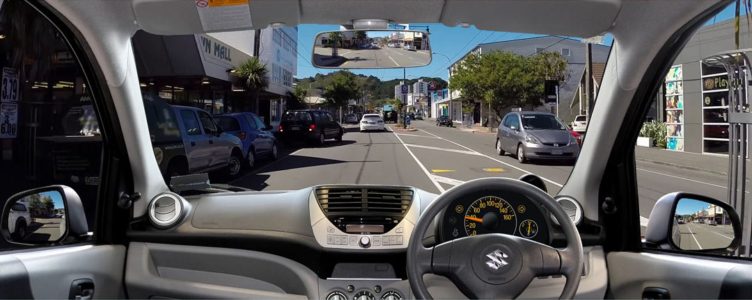 Driving scenario from inside a Suzuki vehicle