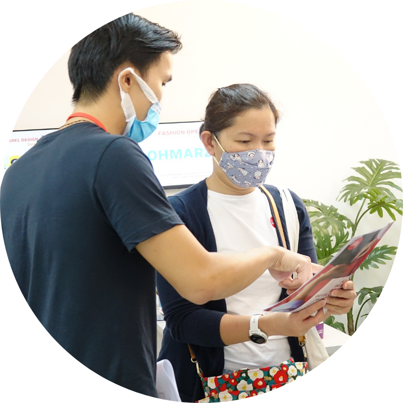 Staff assisting a student