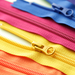 A orange, yellow, pink and blue coiled zipper needed to for TaF.tc's Intermediate Drafting and Sewing class!