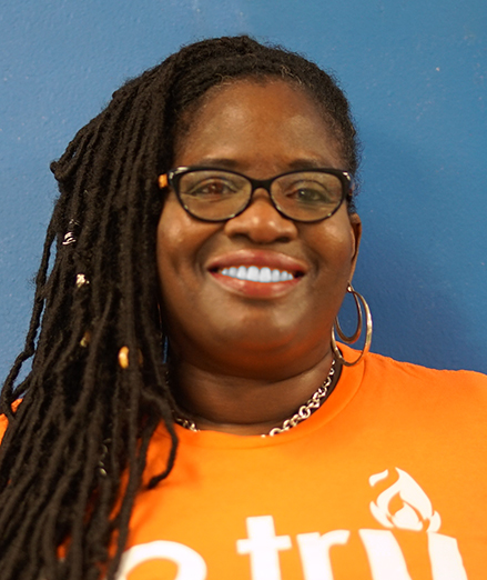 Photo of the Assistant Principal Ms. Delouise Briggs smiling