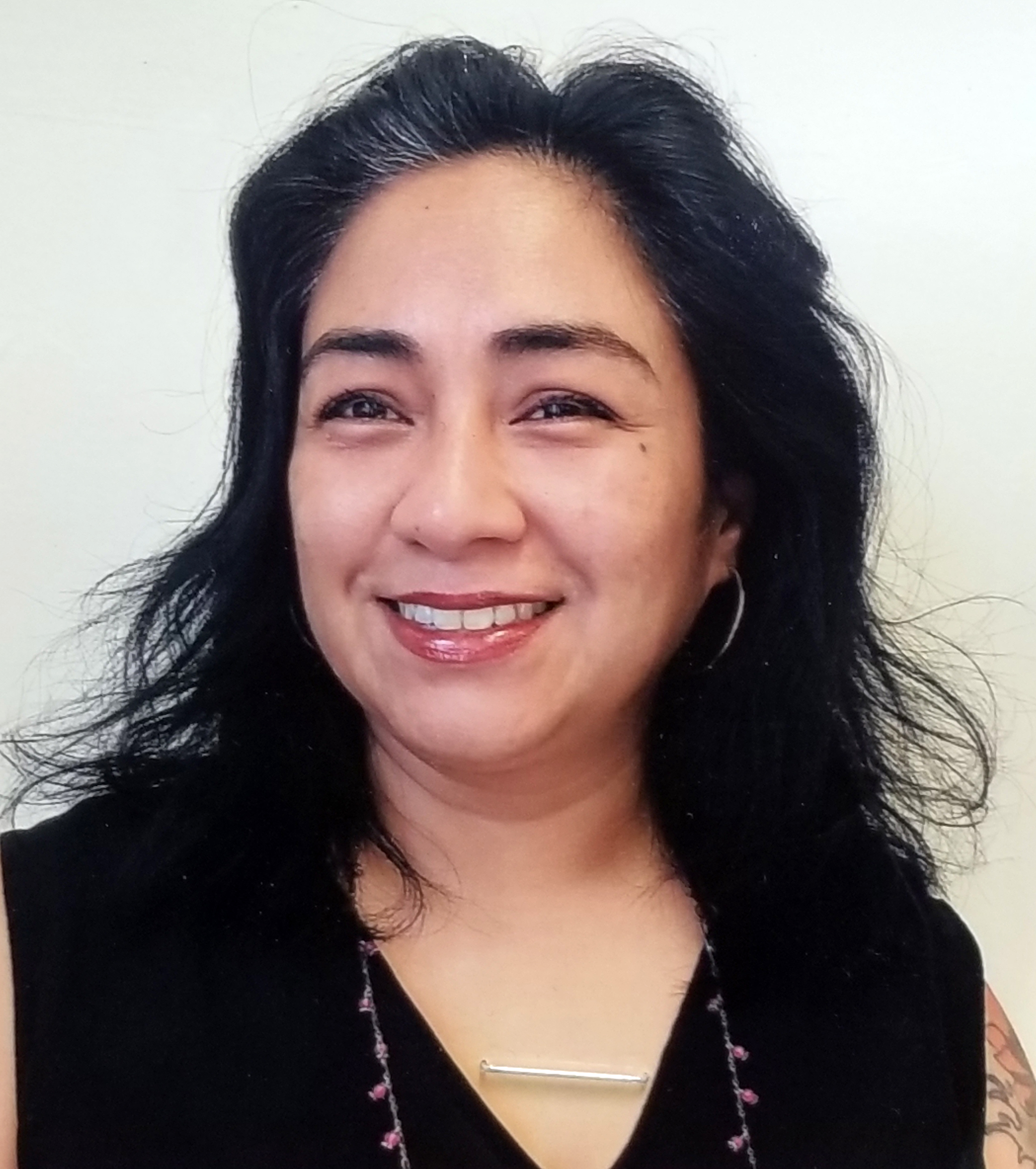 Photo of Ms. Reyes our Community Associate.