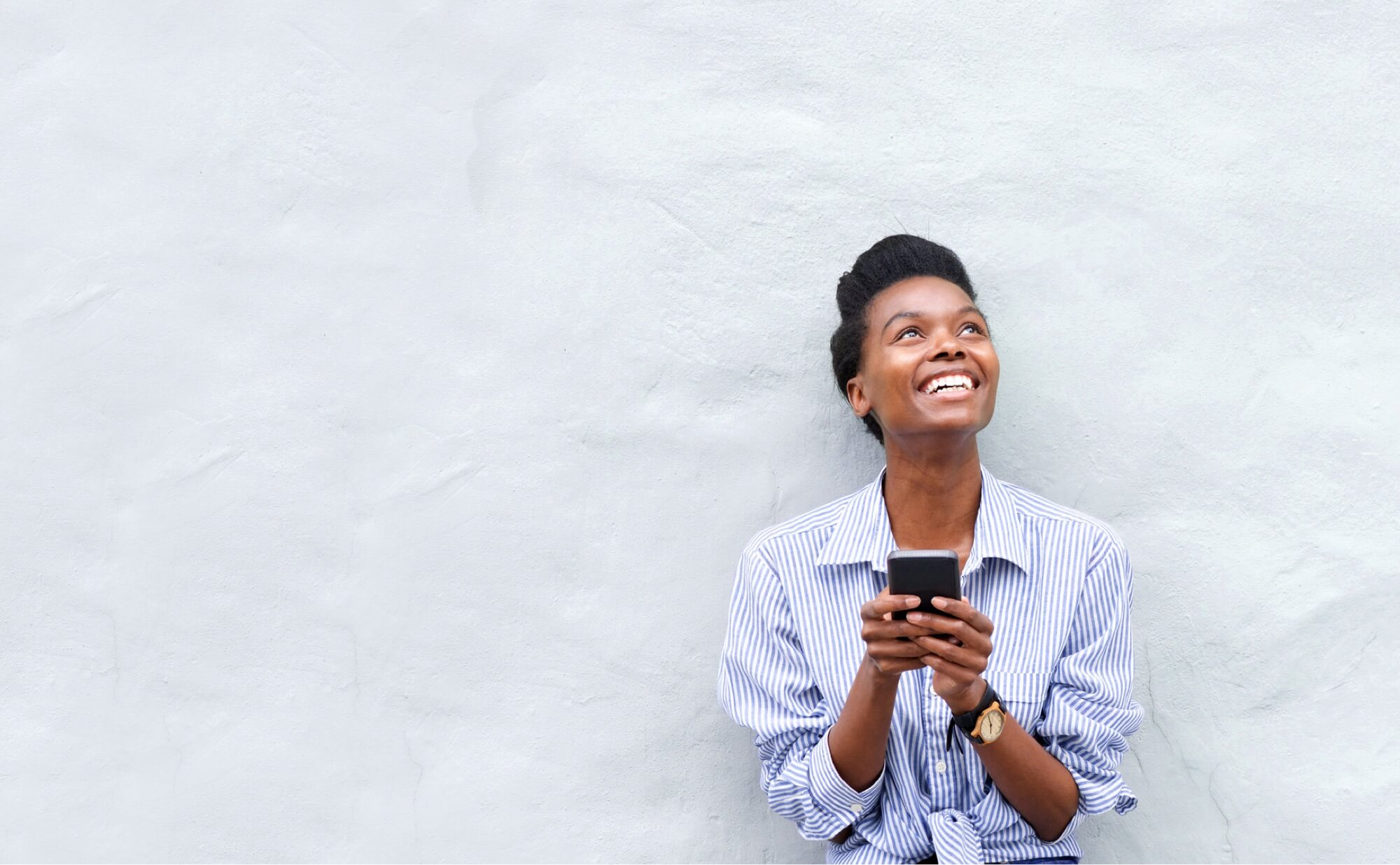 Afro American Girl Texting On Her Phone And Smiling