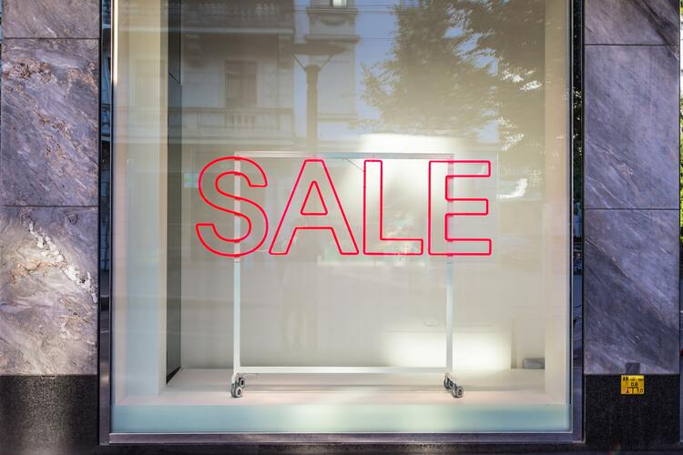 Shopping window display with SALE sign