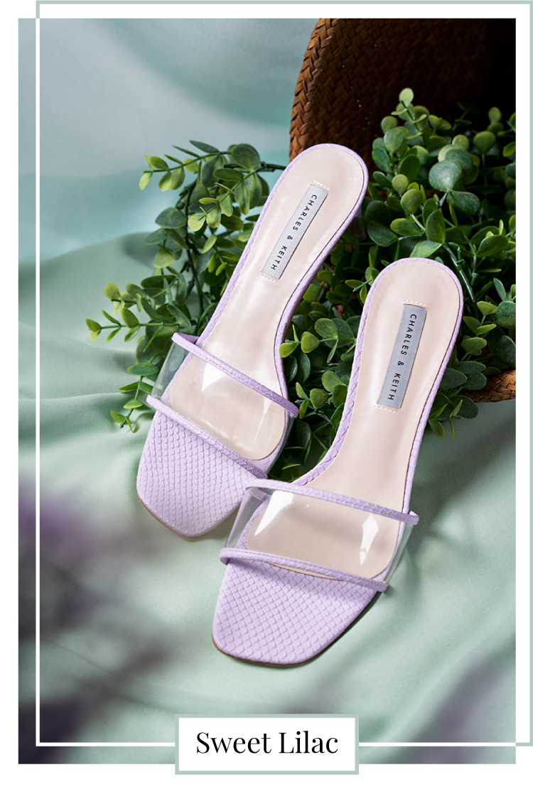 SNAKE PRINT CLEAR STRAP MULES IN ANIMAL PRINT PURPLE