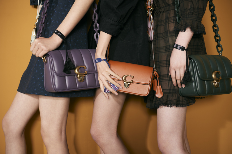 Models carrying the new 'Quilties Studio' shoulder bag