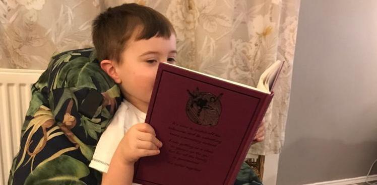 child reading on bean bag