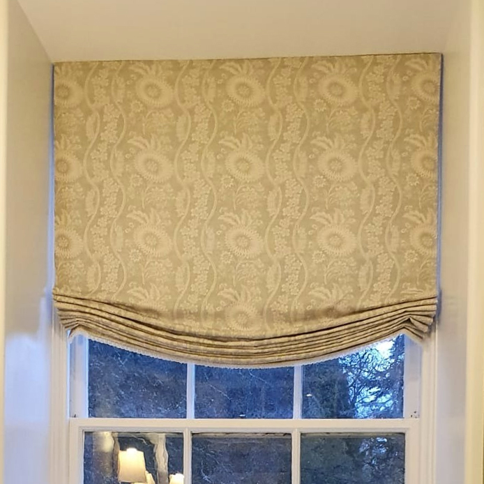 Yellow roman blinds in a kitchen