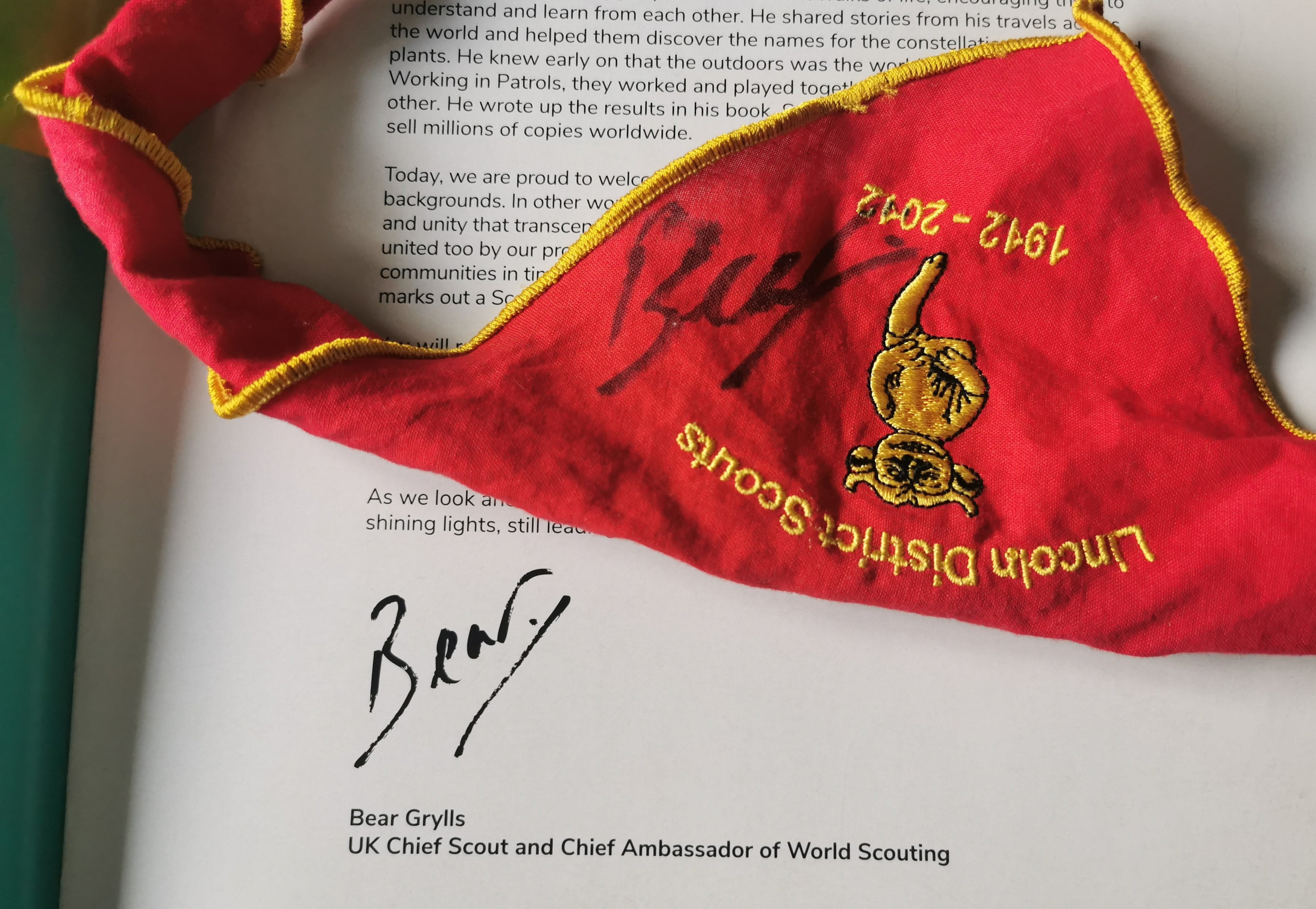 Bear Grylls signature on a necker and book