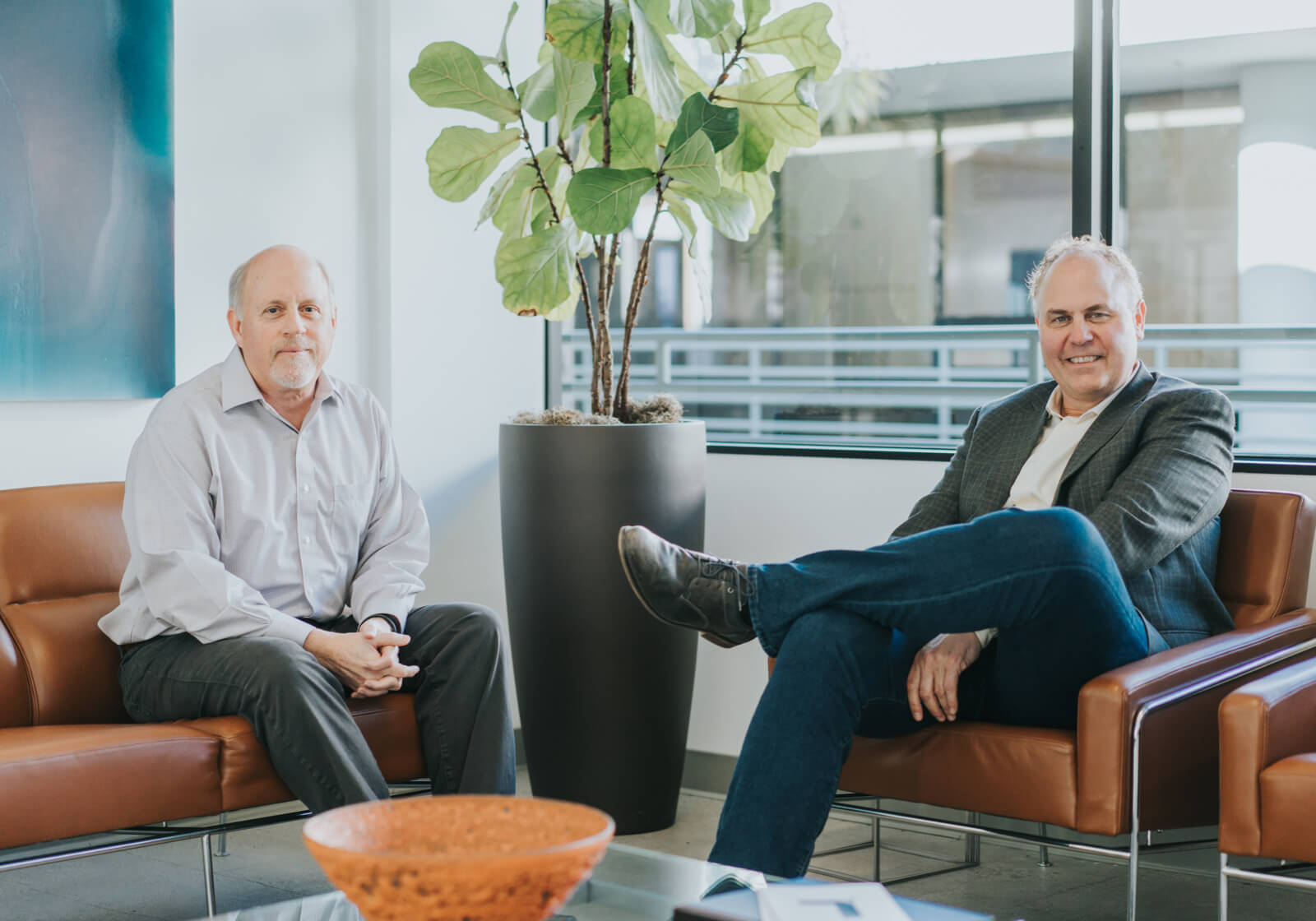 Two professional men sitting in an office setting