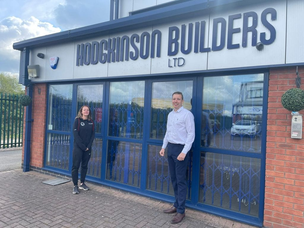Chloe Maudsley of DIS and Robert Hodgkinson of Hodgkinson Builders outside the business