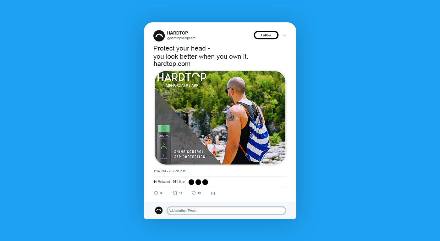 Twitter mock up showing a bald man walking along the beach. At the top, it says protect your head, you look better when you own it.