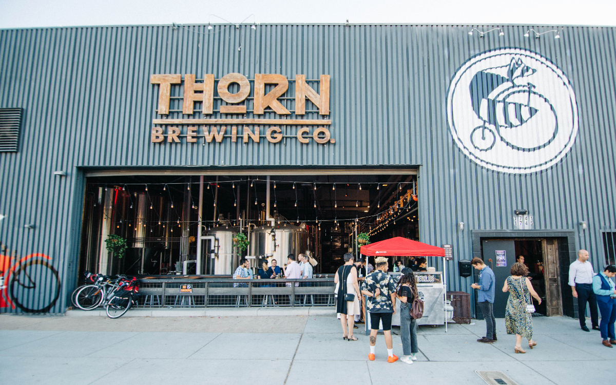 Photo of the front of the Thorn Brewing Co building during the day.