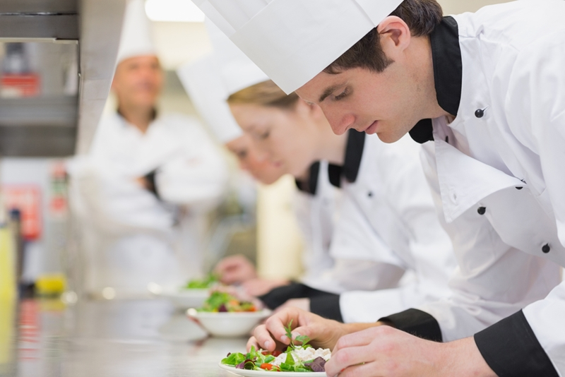 Boarding school students learning about different cuisine in a cooking class.