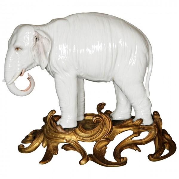A Large Porcelain Elephant in a Gilt Rococo Ormolu Base