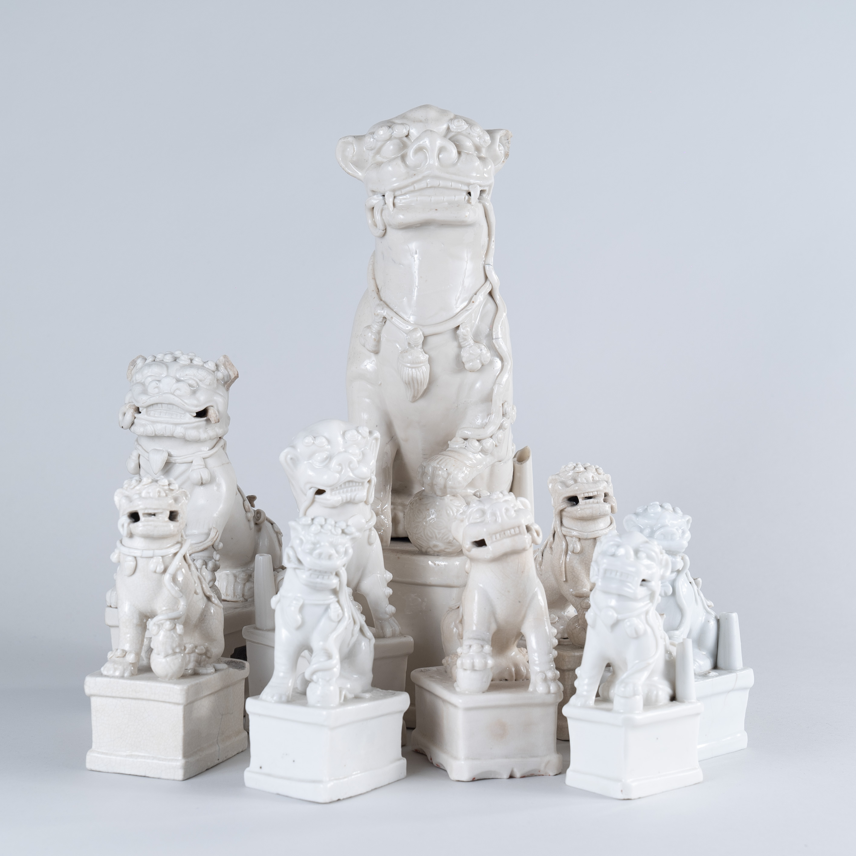 Collection of nine Chinese Blanc De Chine porcelain Foh Dogs, circa 1690