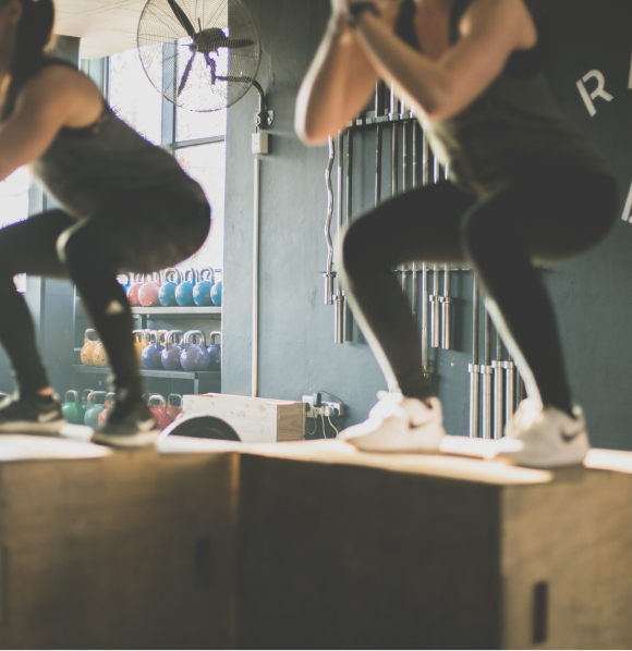 People performing a box jump