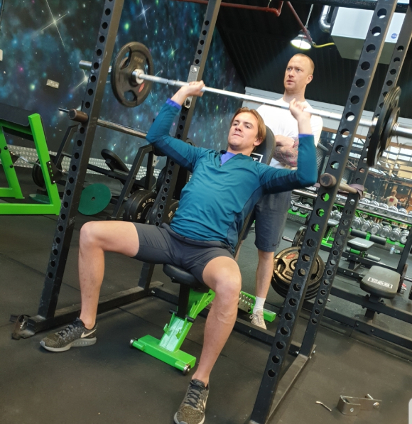 Person performing an overhead press