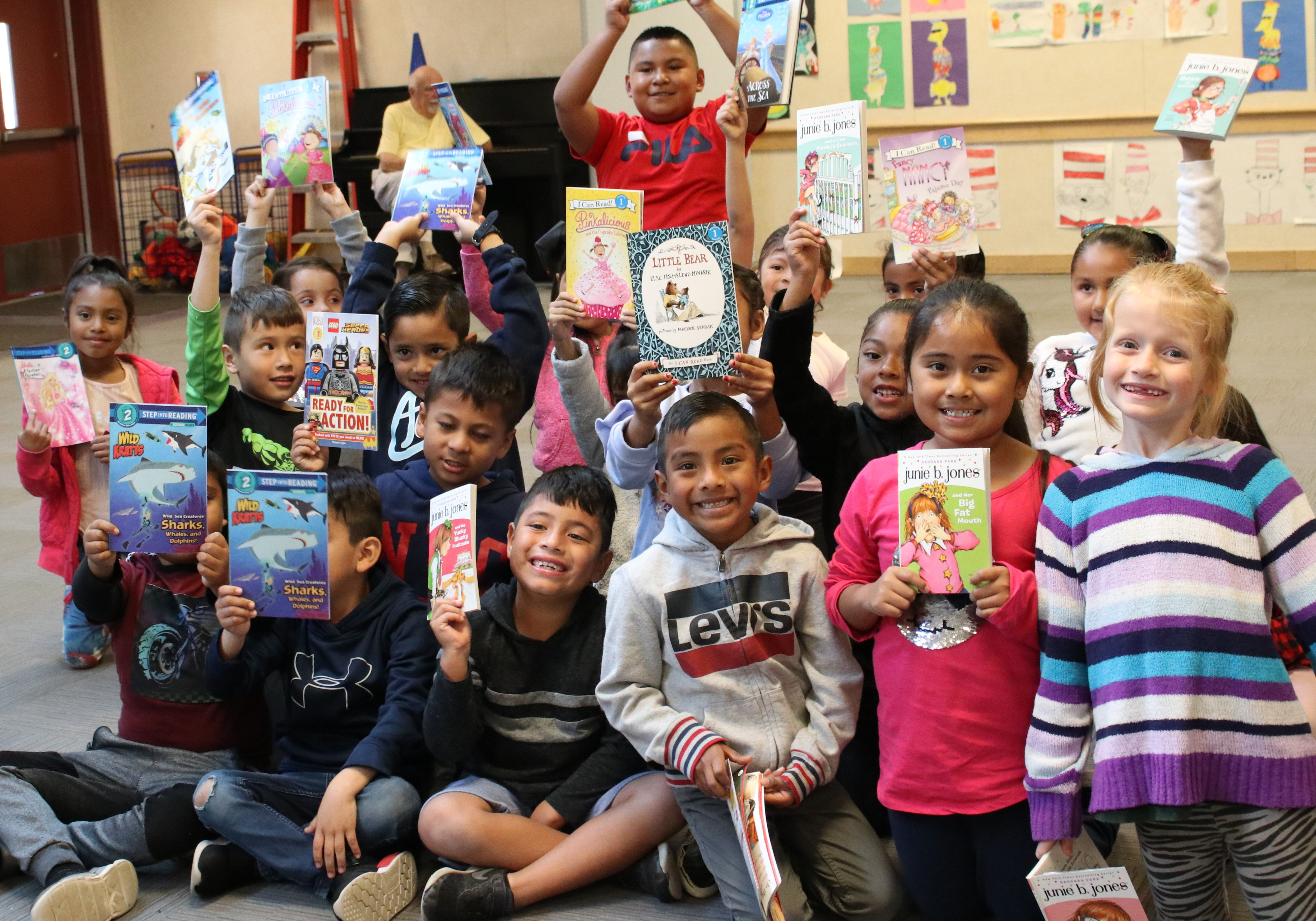 A group of children showing their books