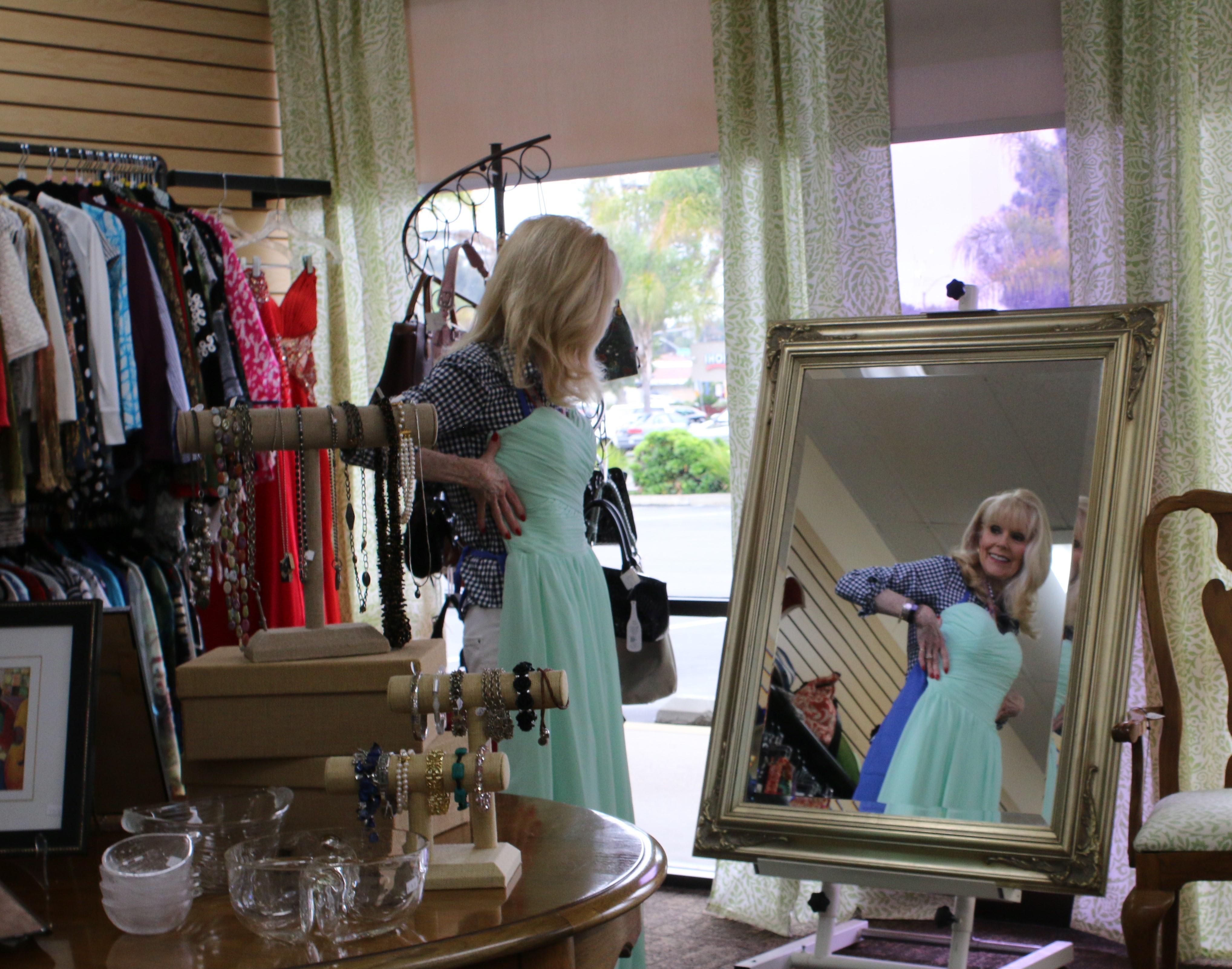 A woman fitting a cyan dress