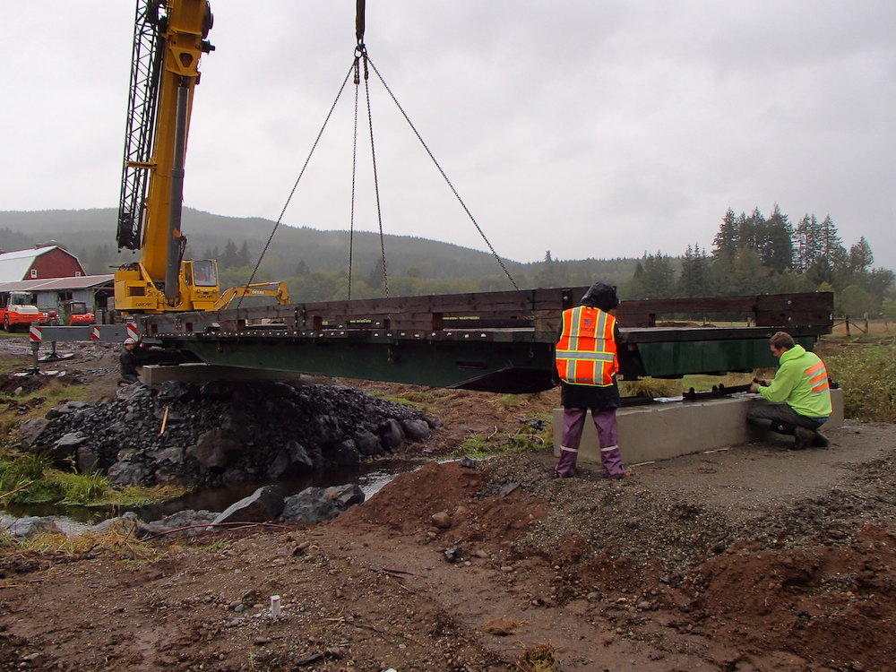 Bridge being placed over Gosnell Creek to improve agricultural access and aquatic habitat