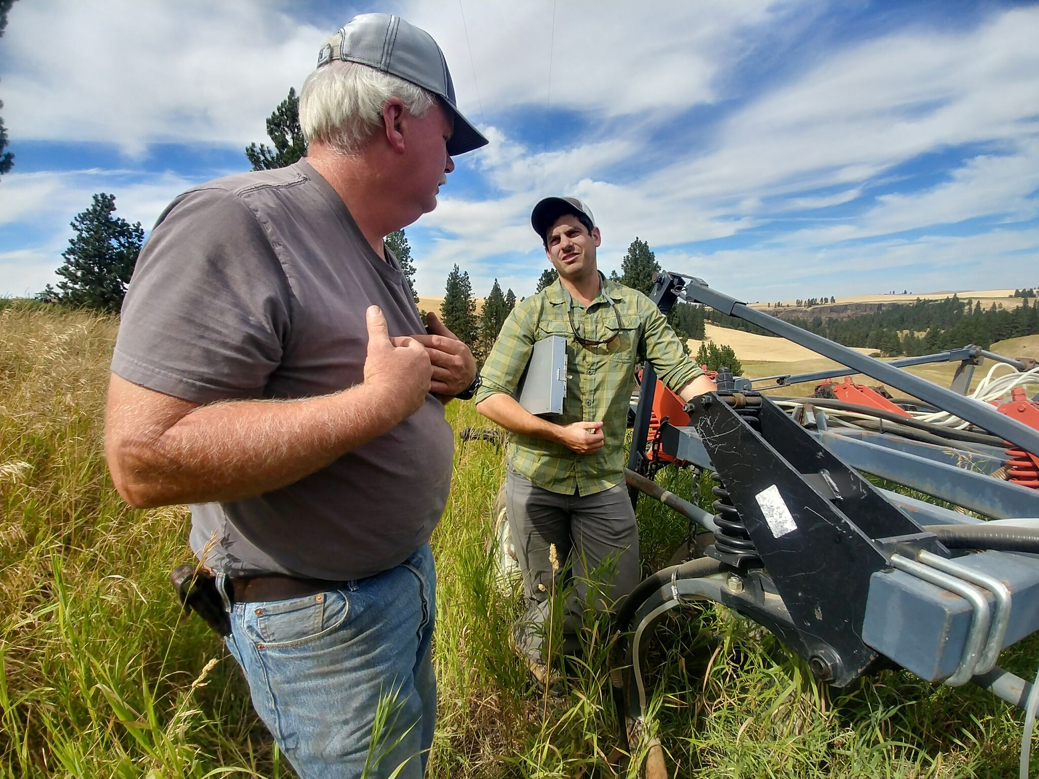 Conservation Coordinator works with local farmer about adopting no-till practices on their operation.