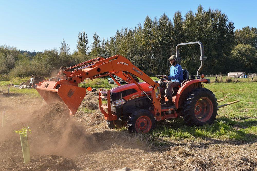 Farmer Rawley of Early Bird Farms works on a habitat restoration project on his farm