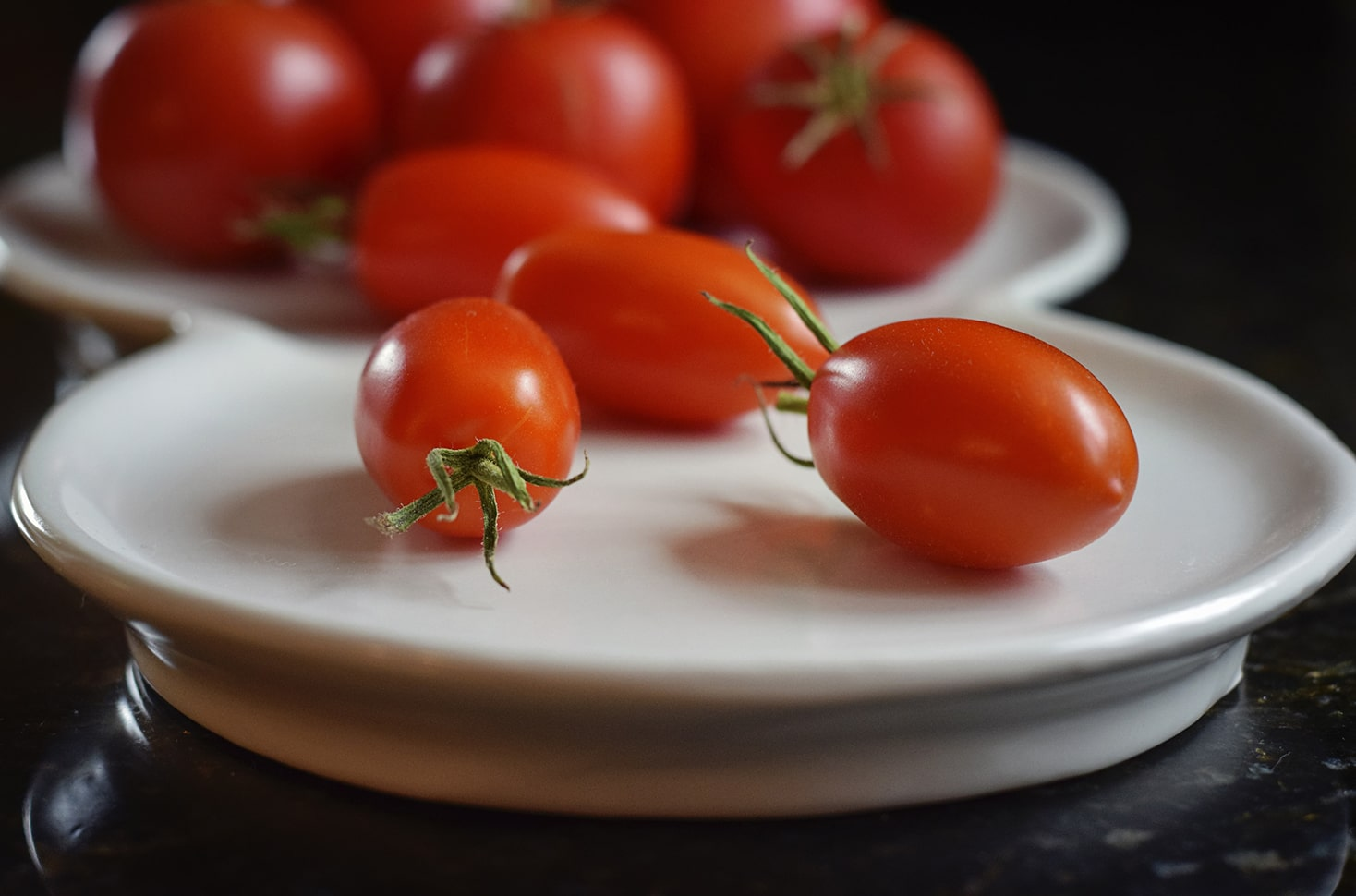 Plate with tomatoes on it.