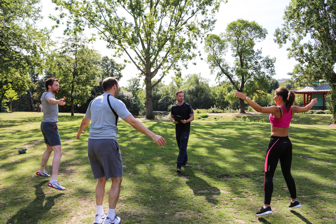 workout with personal trainer in park