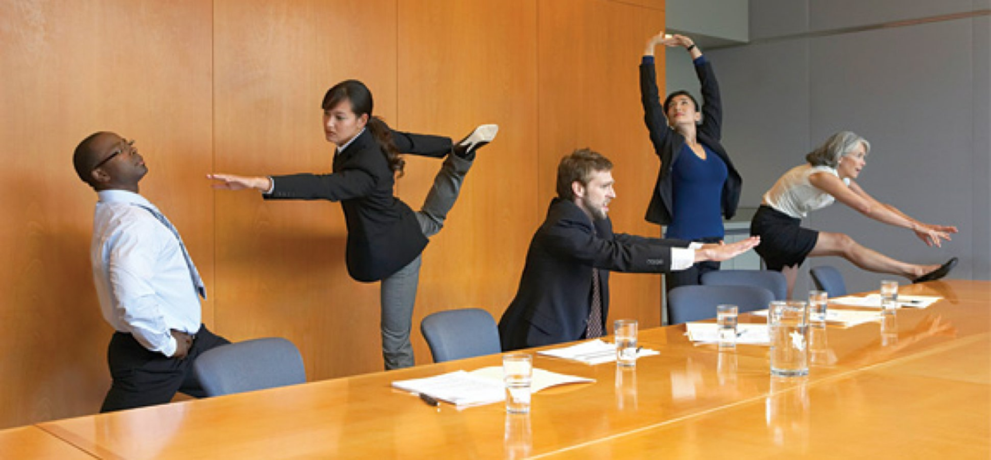 colleagues are doing yoga in the office