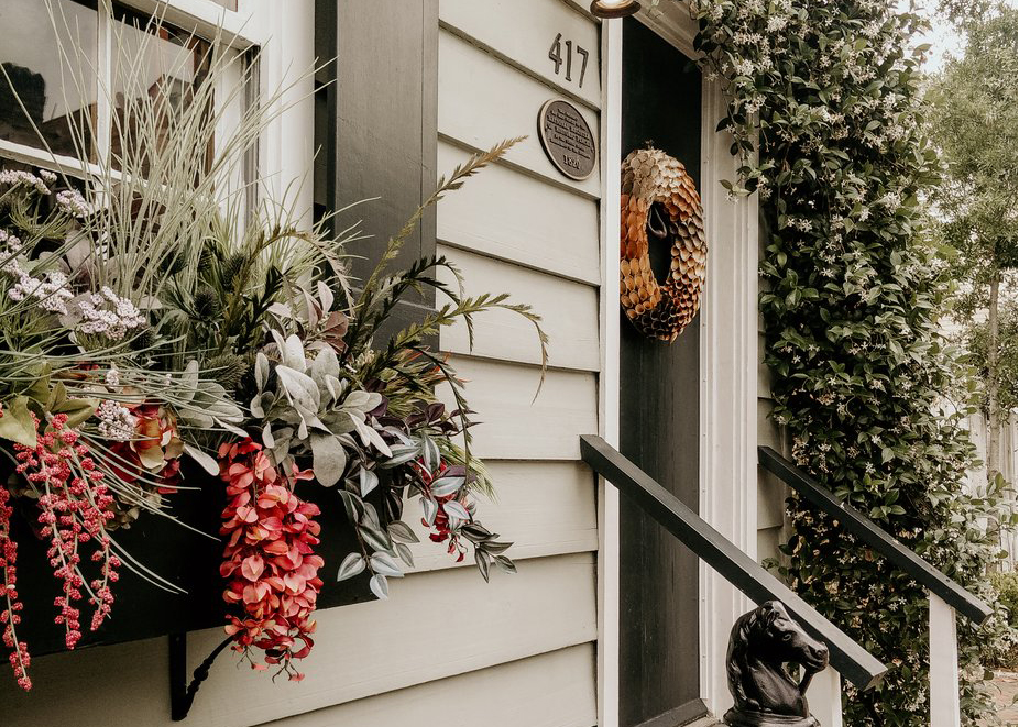 front of home with flowers - home and auto insurance