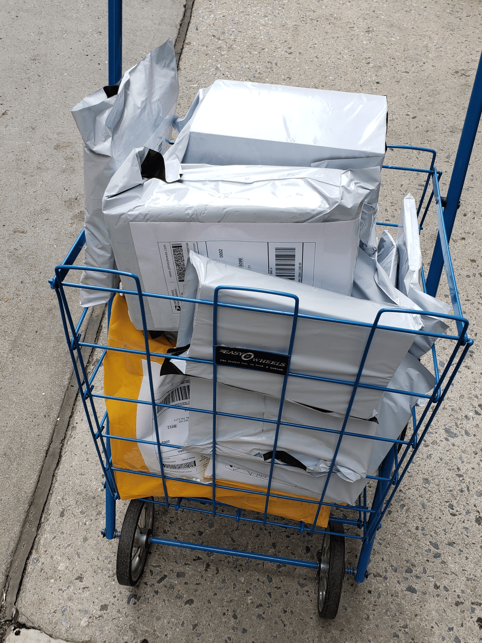 A cart full of packaged books going out to clients.