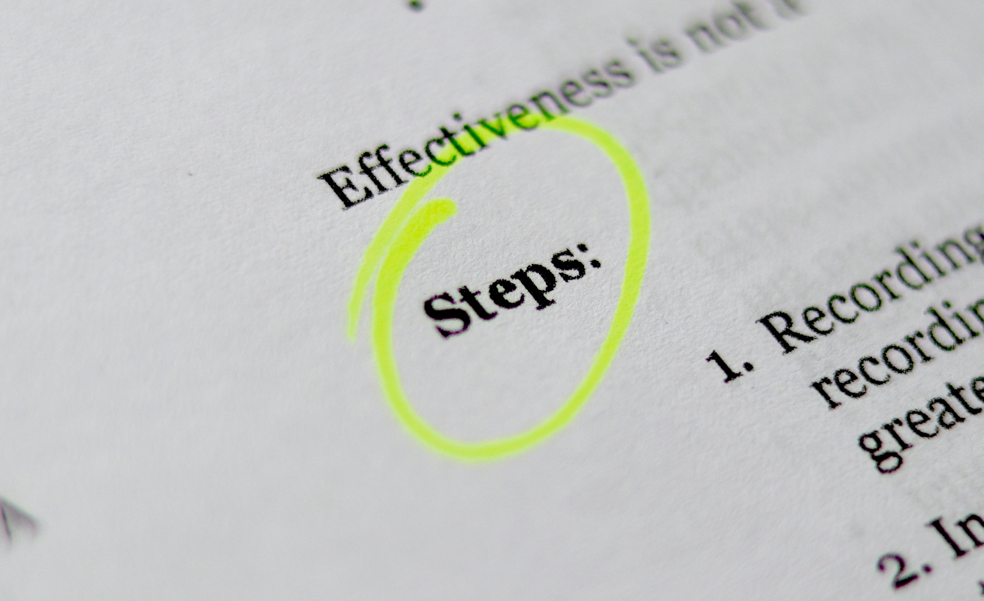 A paper with the work 'Steps' circled with a highlighter