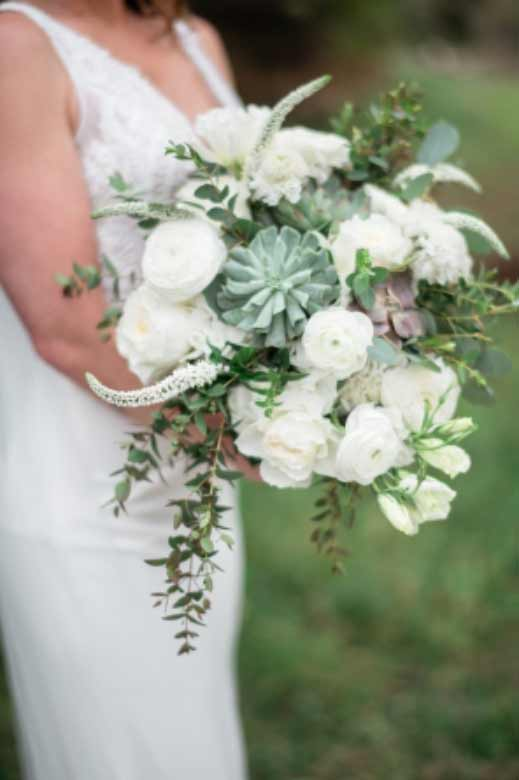 A close up of a brides bouquet at a wedding in Houston, TX.