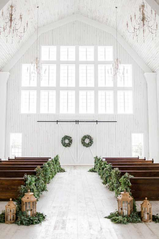 A wide shot of the inside of a barn Wedding in Houston, TX.