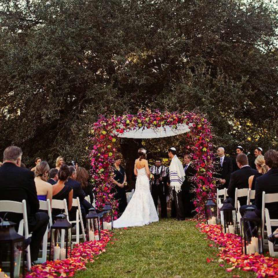 A wedding couple in Houston, TX during their festive ceremony.