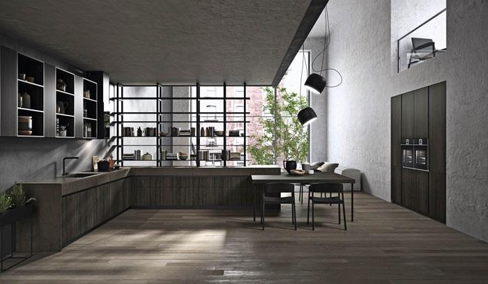 Cucina moderna nera e legno con apertura a gola scura e top in gres con cassetti sottotop in gres
