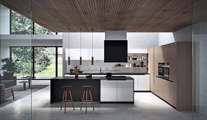 Cucina moderna bianca con isola centrale con tavolo da colazione in essenza olmo e laccata bianca lucida