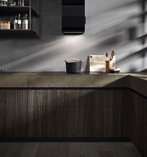 Dettaglio della cucina angolare con cassetto sotto top in gres e cassetti e cestoni estraibili con gola