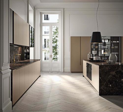 cucina con isola minimal di lusso con piano e fianchi in marmo