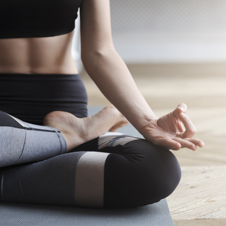 a woman in yoga pose