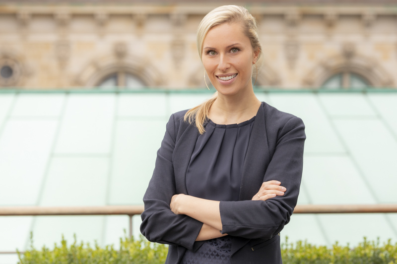 a young professional business female smiling towards the camera