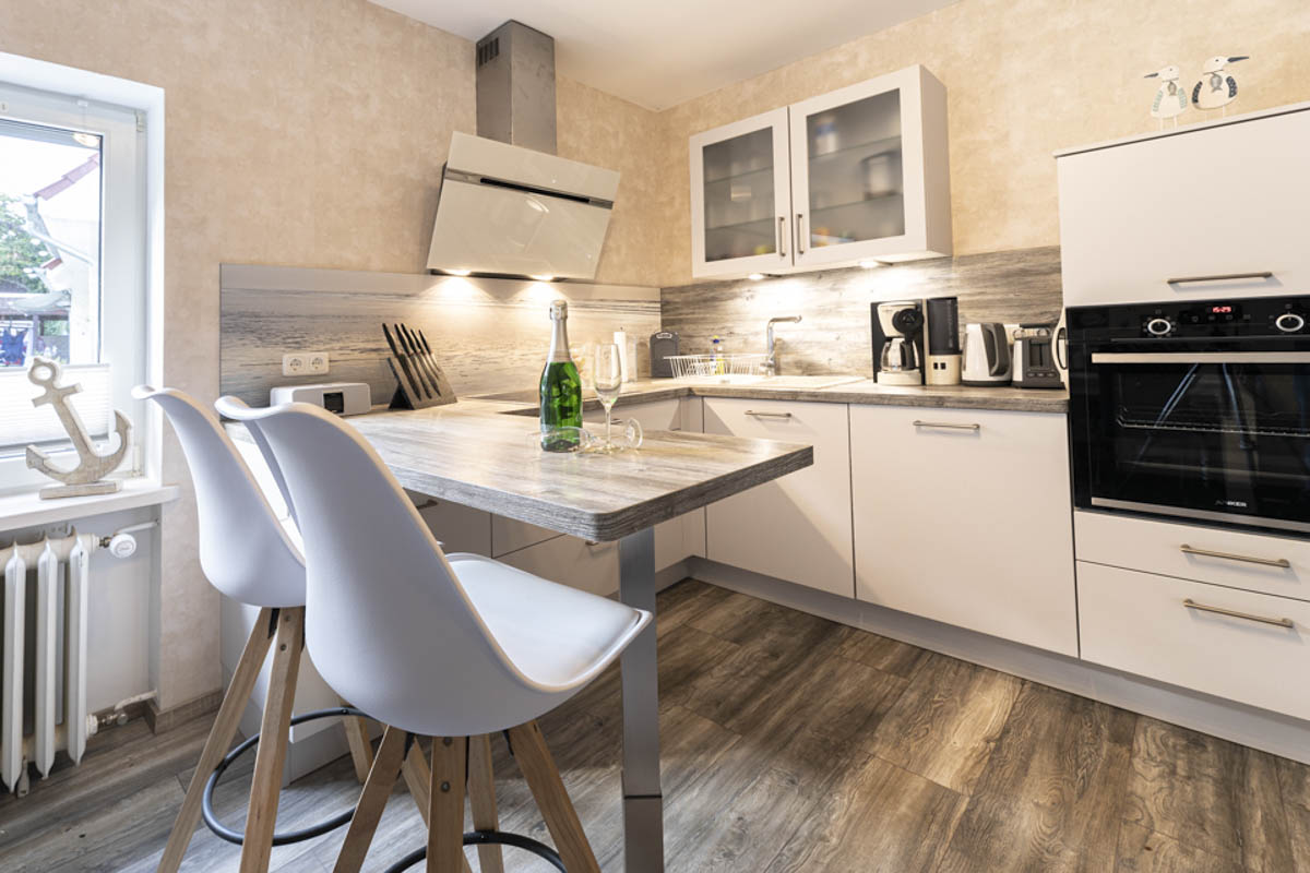 A modern and light kitchen of an holiday apartment