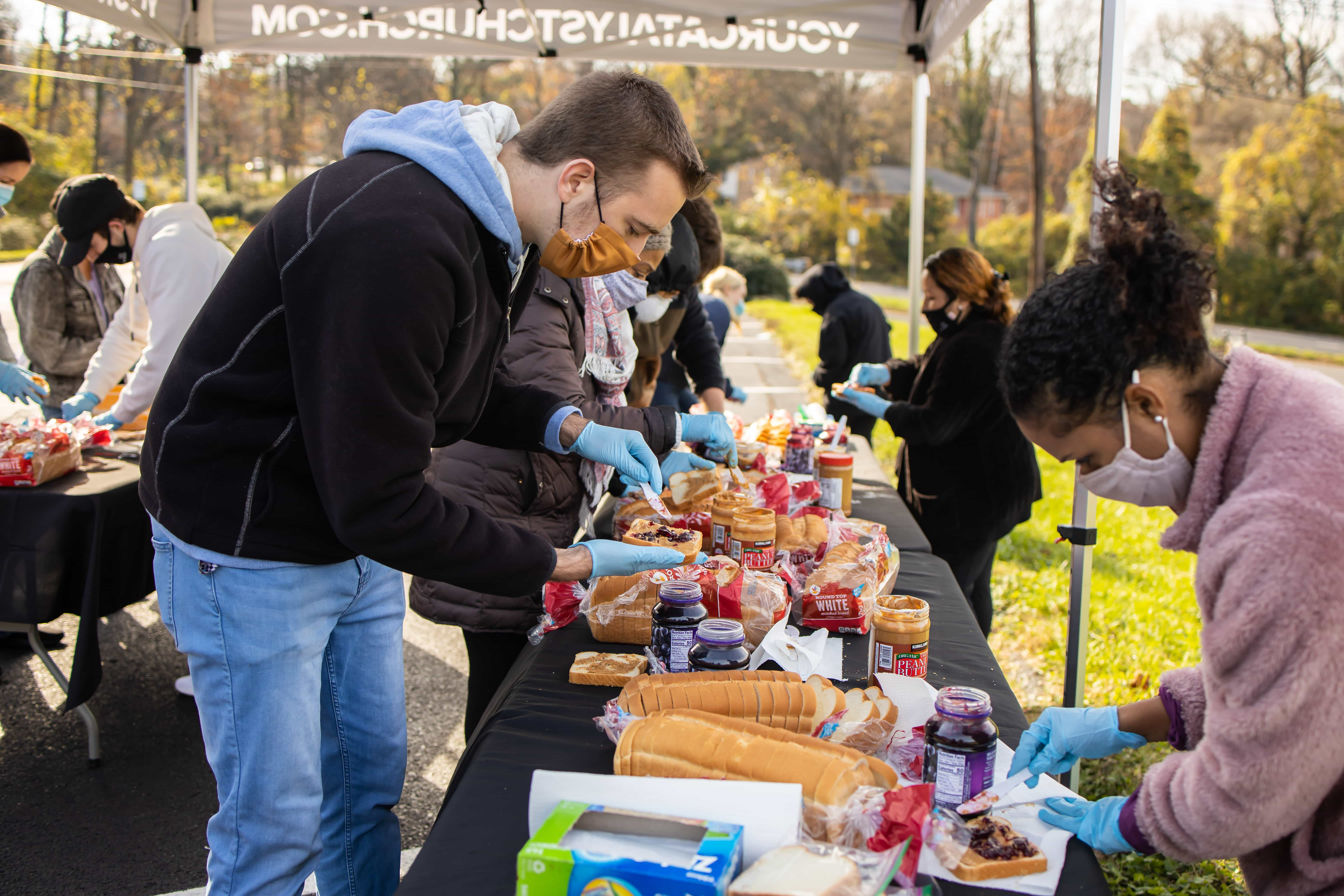 a photo of catalyst team making sandwiches to donate.