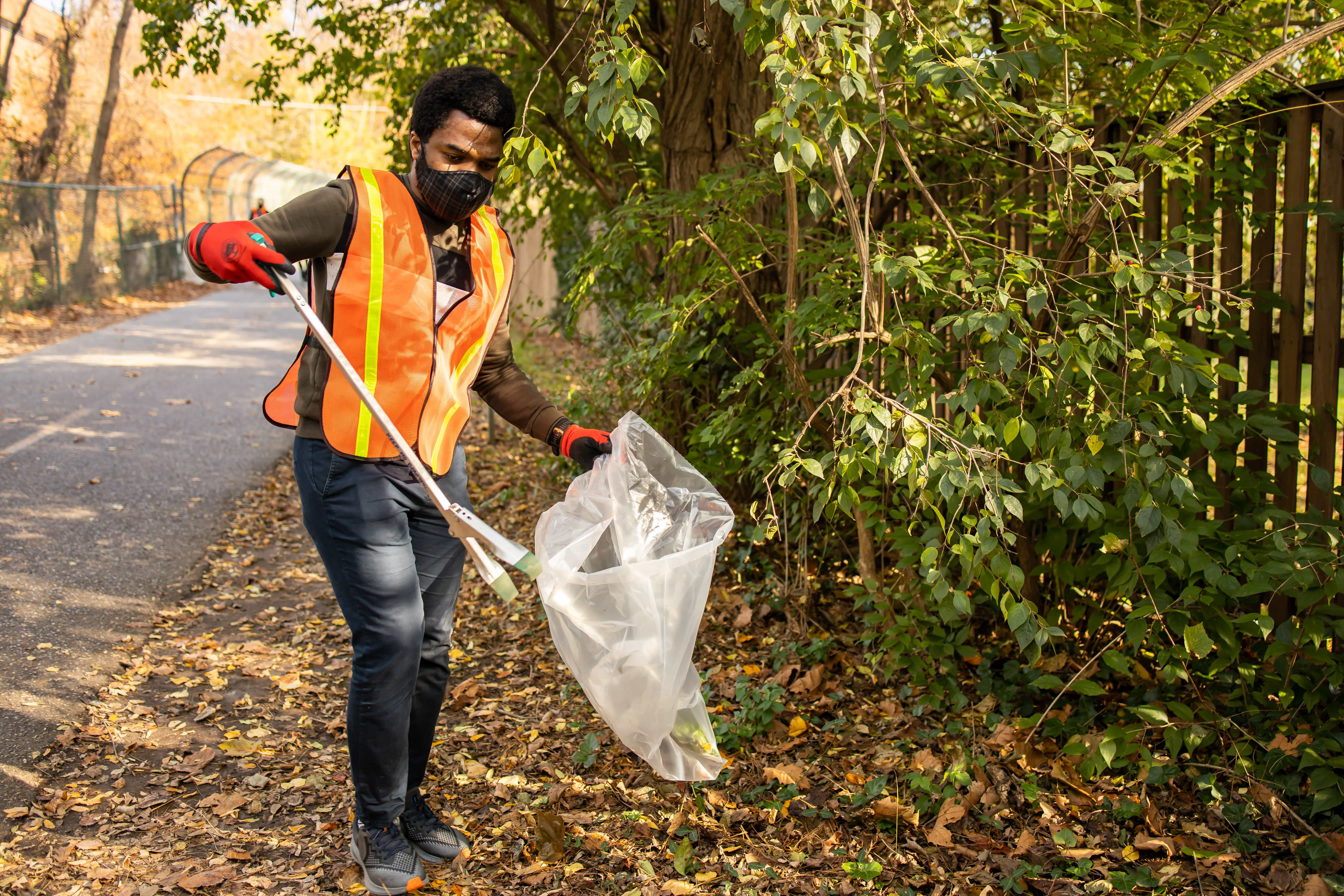 Catalyst team member picking trash in a state park.