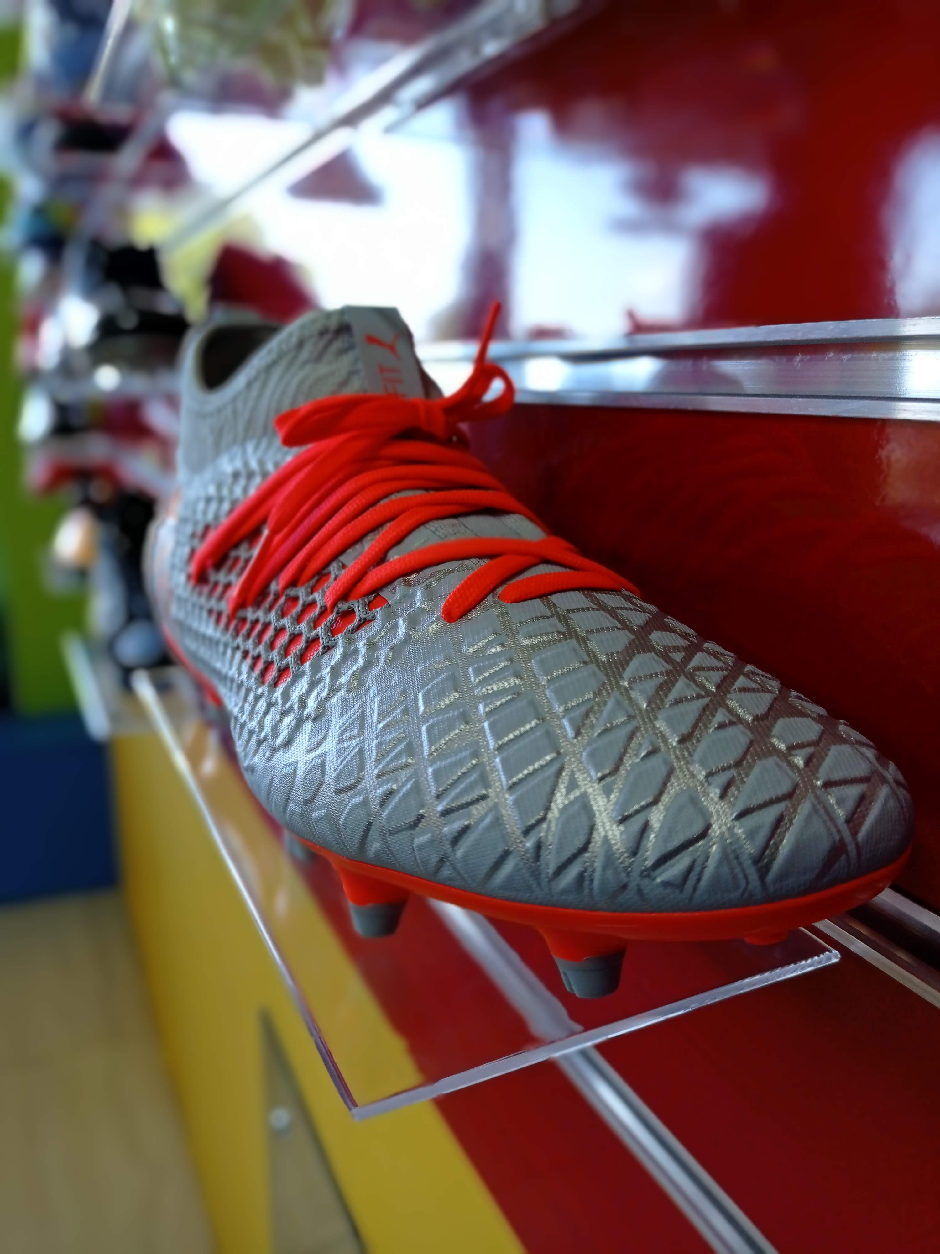 Picture of Puma future football shoes on display