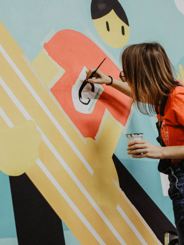 Person painting an office mural.