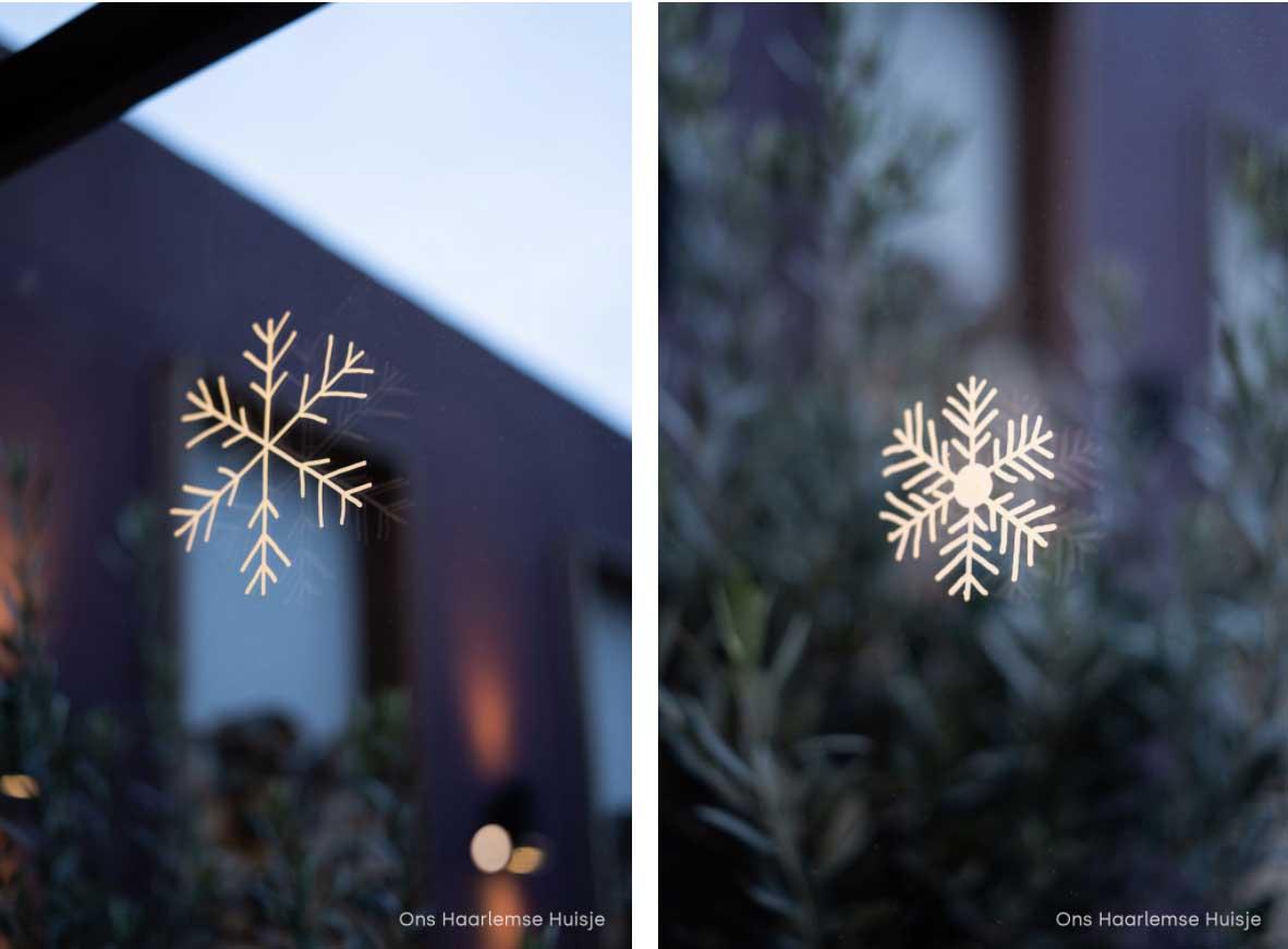 DIY raamtekening sneeuwvlokken met witte krijtmarker