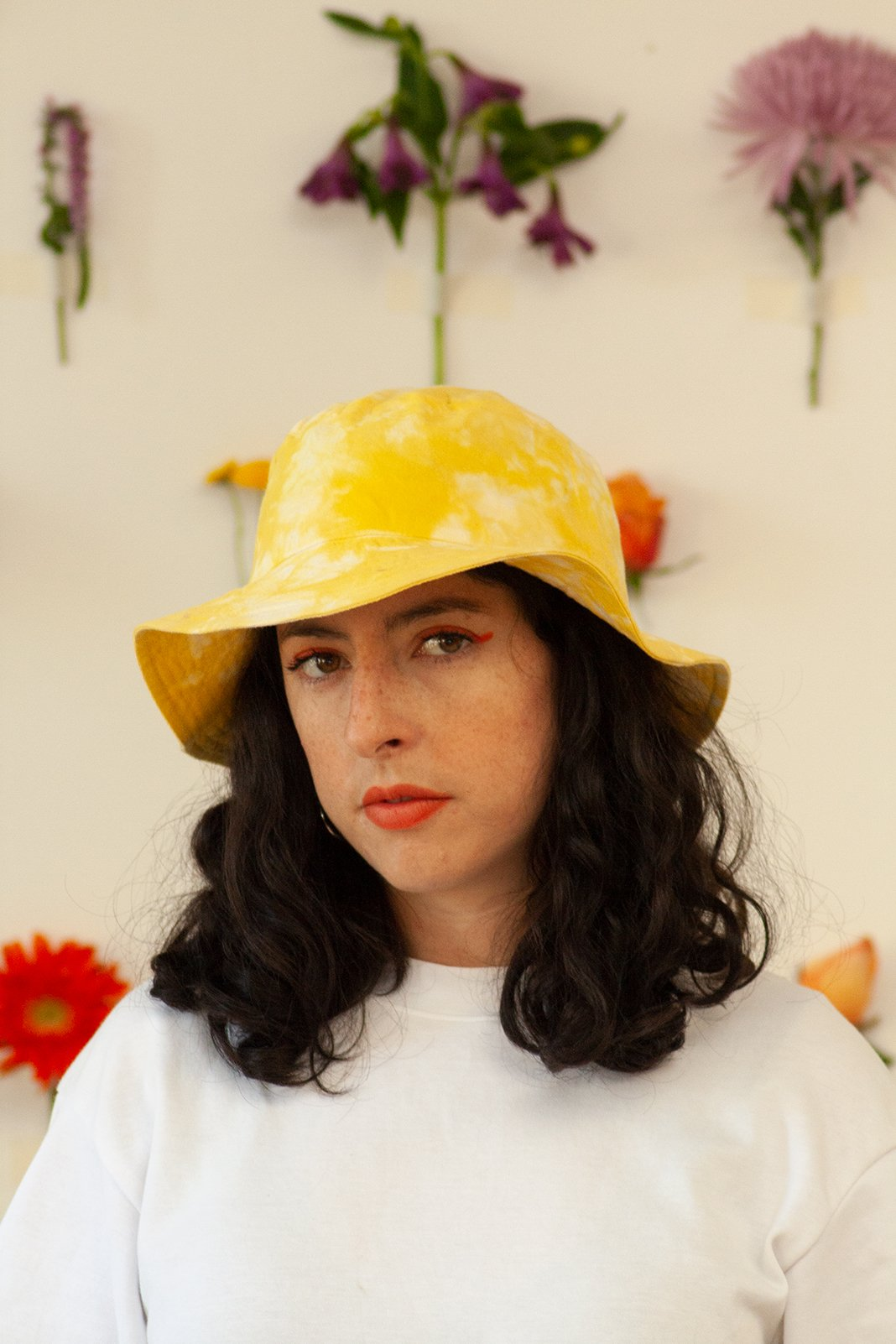 Hand-dyed bucket hat with natural turmeric pigments. This is is a one-of-a-kind piece that's perfect for your summer outfit.